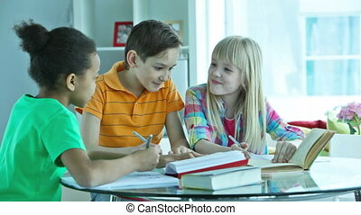 Homework club - Group of pupils studying together at the...