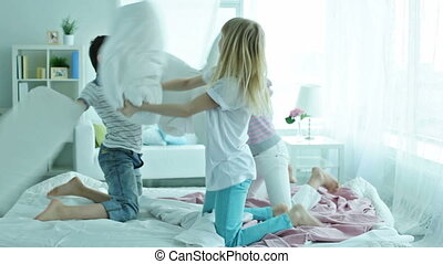 Fun - School friends having fun pillow fighting vigorously