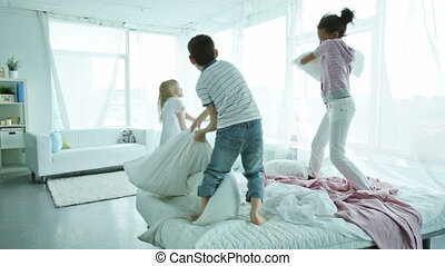 Pillow fighters - Children staying at their place and...