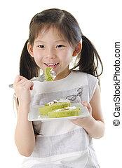 Enjoying dessert - Little Asian girl is enjoying her dessert