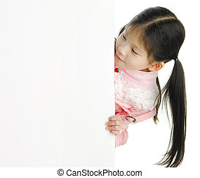 Blank space - Little pan asian girl looking at white blank...