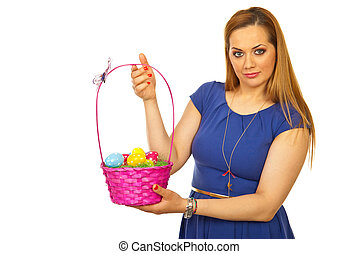 Beauty blond woman showing Easter basket isolated on white...