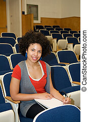African American studying in lecture hall