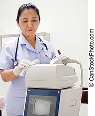Nurse Cleaning Hospital Equipment; Computerized Optometer