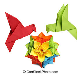 origami humming-bird over flower kusudama over white...