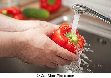 man washing vegetable