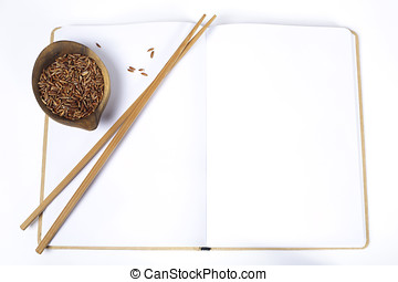 uncooked rice and chopsticks - uncooked rice, chopsticks and...