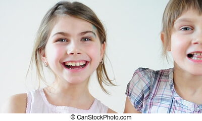 children laughing and making faces - Two happy playful...