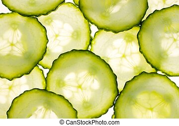 cucumbers sliced as illuminated light background