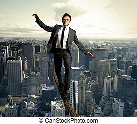 Equilibrist businessman - Businessman is balancing on a rope