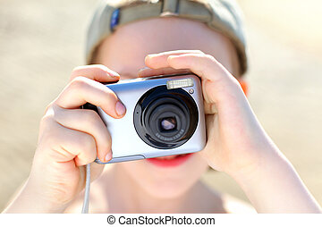 boy with camera - small boy with photocamera outdoor