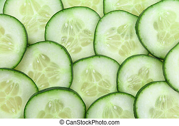 Cucumber slices background - Photo of cucumber slices as a...