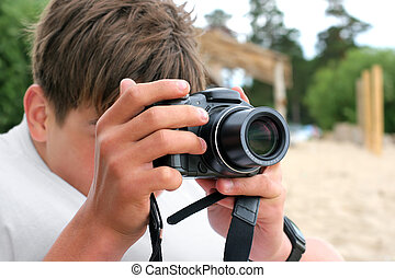 teenager with camera - teenager with digital photo camera...