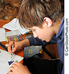 schoolboy - The boy doing lessons and with concentration...
