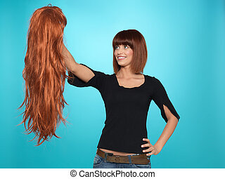 pretty woman admiring long hair wig - beautiful, young woman...