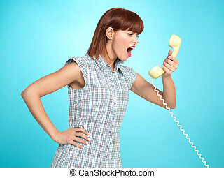 attractive young woman screaming on the telephone -...