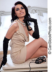 Fantasy Woman - Young gorgeous brunette in sexy dress. Focus...