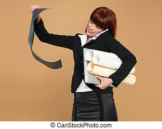 busy, young businesswoman holding laptop, papers, telephone...