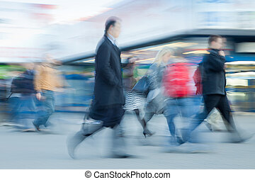 People rushing to work - Blurred image of people rushing to...
