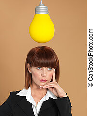 attractive, young businesswoman with light bulb, thinking