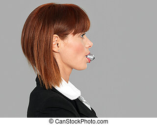young businesswoman, with light bulb in mouth