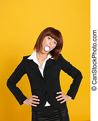 attractive, young businesswoman with egg in mouth