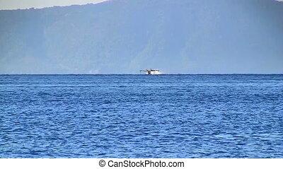 Aircraft landing at blue sea - Aircraft landing at blue...