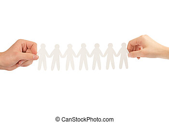 paper people in hands isolated on a white background