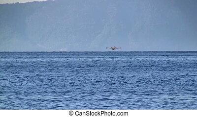Aircraft landing at sea - Aircraft landing at blue sea