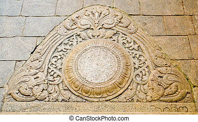 """""""moon"""" stone at the entrance to the buddhist temple"""