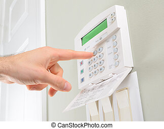 House alarm - pressing the code on a house alarm