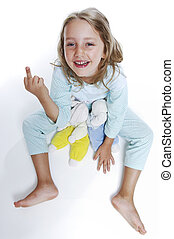 Girls in pajamas shows the middle finger sitting on the...