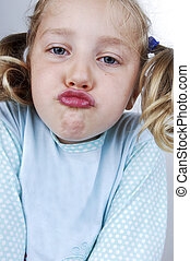 Girls in pajamas makes faces - Girls in pajamas and pigtails...