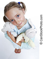 Smiling girl in pajamas - Girls in pajamas with toys in her...