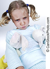 Girls in pajamas makes faces - Girls in pajamas with toys in...