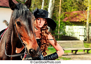Beautiful young woman in medieval costume is riding on...