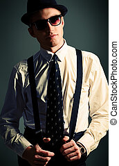 suspenders - Portrait of a handsome young man in a suit....