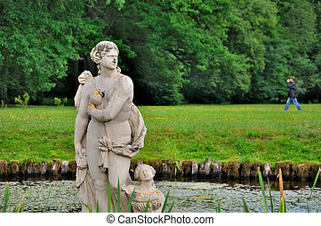 Sculpture of a naked woman in the lake of Schloss Fasanarie...