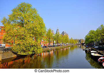 Beautiful river with boats in Amsterdam, Holland Netherlands...