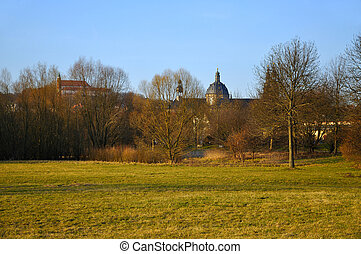 The view at the Dom (Cathedral) and a Monastery on a Frauenberg from Aue Park in Fulda, Hessen, Germany