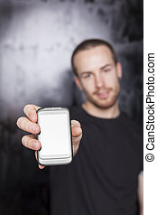 Men showing screen of cell phone, focus on device