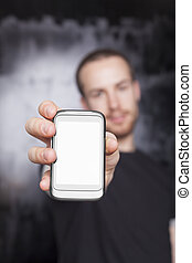 Men showing screen of cell phone, focus on smartphone
