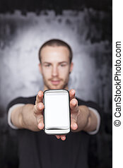Man showing screen of smartphone, black t-shirt and...