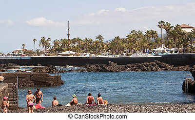 People sunbathing on the beach of San Telmo in the Spanish...