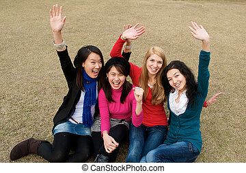 Female Students Cheering - Group of 4 college students...