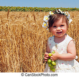 Jewish Holidays - Shavuot - Little girl eats fresh green...
