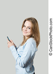 Girl dialing on cell phone - Girl dialing an phone in her...