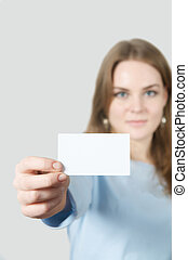 Young woman showing blank business card