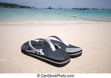 Beach Sandals - A pair of sandals on the beach