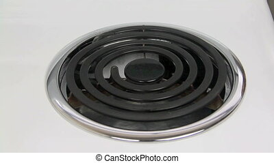 Oil On Hotplate - Cooking oil burning off on a stove hot...
